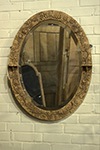 irish cork oval mirror with raised foliate details