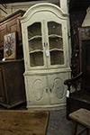 swedish painted corner cabinet with domed cornice, glazed upper doors.