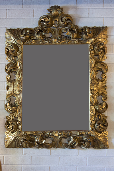 french gilt mirror carved in scrolls and acanthus leaves