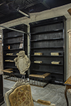 pair of black bookcases with multiple adjustable shelves.