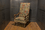 french needlepoint begere chair with nail head trim and fringe accent.