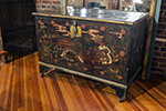 english painted trunk with single latch and large storage area inside, casters on all feet
