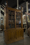 english oak gothic display cabinet with two glazed doors over two panel doors