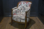 french armchair with curved back and turned arms