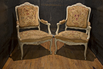 pair of louis xv painted needlepoint open armchairs