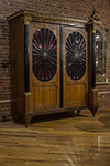 french neo-classical cabinet. the oval glazed inserts on doors with ebony wheel shaped.