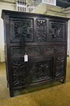 english oak court cupboard with carved doors and drawers