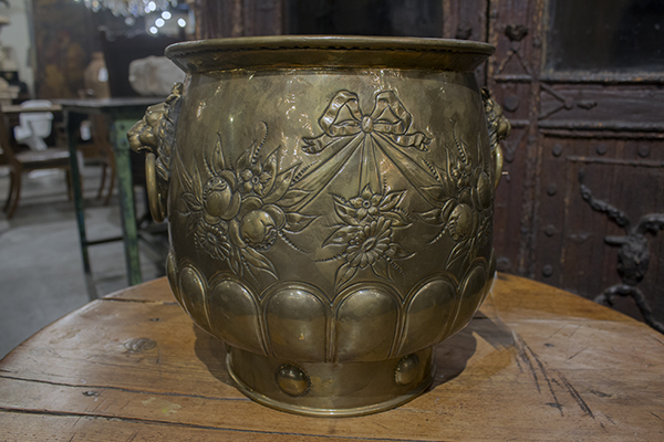 large english victorian brass jardiniere, with floral, ribbon and swag repousse decoration and brass lion's head ring handles.