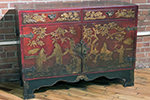 english red lacquered commode with japanning on front, top and sides