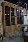 english display cabinet with solid glass doors above panel doors.