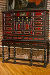 flemish ebony and red tortise shell cabinet on stand