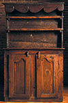 french cupboard with two paneled doors below open shelving on top,  detail crown