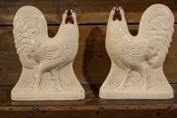 a pair of staffordshire pottery cockerels with red comb and wattles