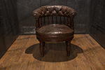 english leather desk chair with button tufting on seat and back