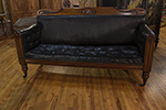 william iv mahogany framed leather sofa with tufted seat, turned legs on casters