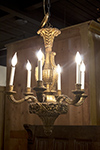 six arm gilded and carved chandelier
