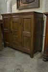 flemish  walnut commode with single door storage and key lock.