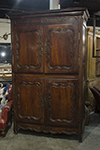 french four-door provincial armoire with brass escutcheons and hinges