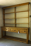 english pine dresser with three frieze drawers under the open plate shelves