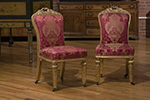 pair of italian side chairs with gilded frame