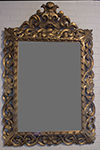 heavily carved gilded mirror