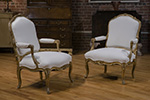 pair of french gilt louis xv armchairs with upholstered cartouche shaped back