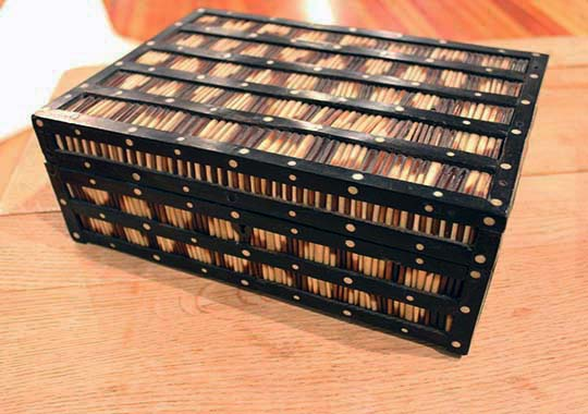 anglo ceylonese ebony and porcupine quill box,  exterior decorated with bands of porcupine quills between borders of ebony inlaid with white circles.