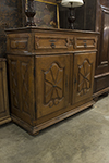 french country oak cupboard with two solid carved doors below two drawers and key locks/pulls.