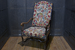 beautiful english needlepoint armchair with curved arms, nail head trim and scrolled legs and stretchers