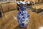 english blue and white oriental vase with scalloped rim