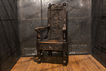 english carved oak armchair in arts and craft style