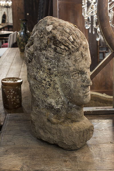 french stone carved head figurine