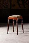english needlepoint stool with turned legs