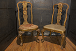 pair of english partial gilt hall chairs with carving on frame and cabriole legs, different fabric on seats