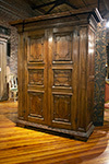 italian two door cabinet with paneled doors and dental moulding detail