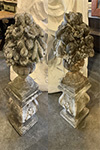 pair of stone baskets on plinths